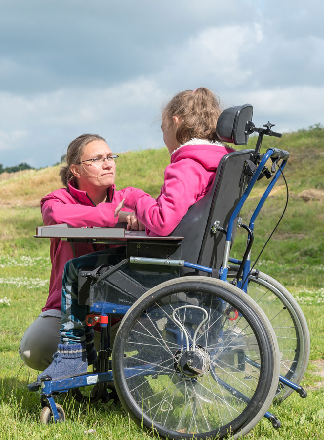 Caregiver Cares for Woman with Disability